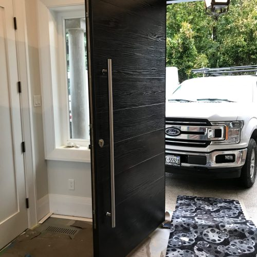 single-front-entry-door-vertical-panels-multi-point-lock